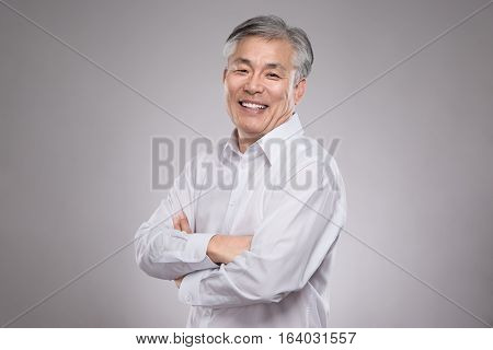 Middle aged asian business man studio portrait photo - isolated
