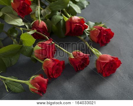 Beautiful bunch of roses on a grey background for a funeral