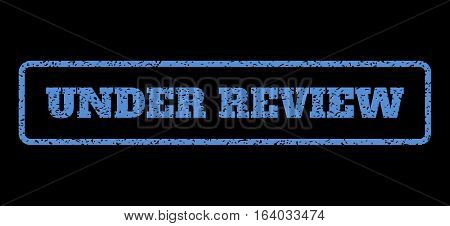 Blue rubber seal stamp with Under Review text. Vector caption inside rounded rectangular banner. Grunge design and dust texture for watermark labels. Horisontal sign on a black background.