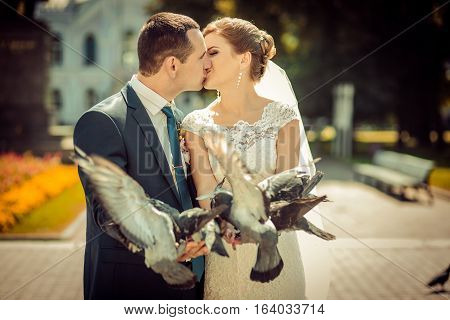 Bride and Groom releasing Doves in Church Grounds