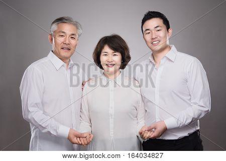 Asian happy family studio portrait - isolated