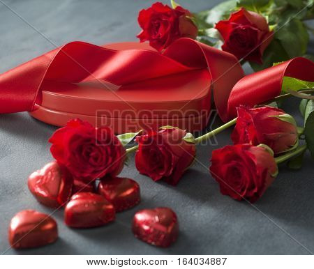 Heart shaped box with red hearts roses and ribbon. Valentines Day concept