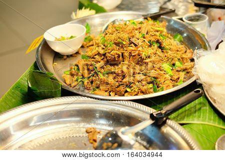 Thai traditional food Larb mushroom salad vegetables lime chili and herbs in market