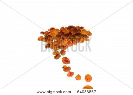 road of raisins and a pile of raisins isolated on white background