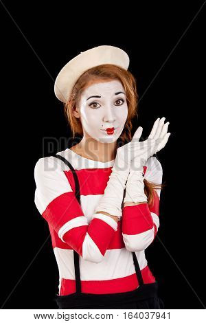 Portrait of the female mime comedian isolated on black background.Studio shot.
