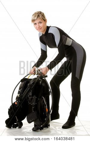 Women diver  checking her dive gear isolated on white.