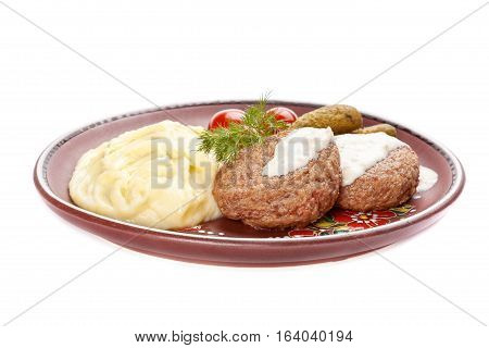 Meat rissoles with mashed potato. White background.
