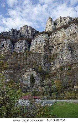 Two high top of Lakatnik rocks with monument and cross,  Iskar river defile, Sofia province, Bulgaria