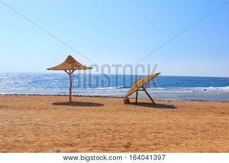 Deserted beach with umbrellas. Red sea. Dahab, Egypt.