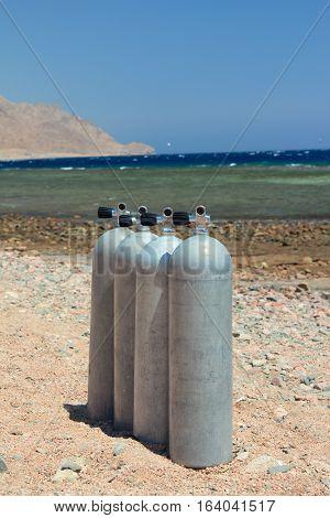 Scuba equipment standing on the sea beach.