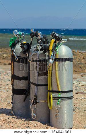 Scuba equipment with jxygen air tank on the beach.