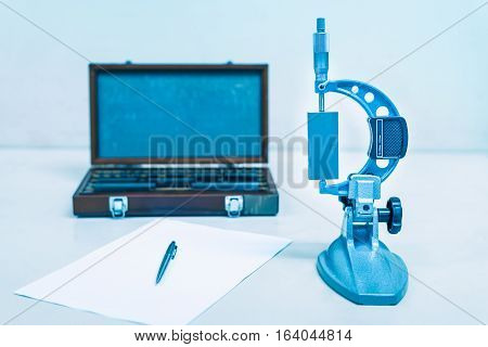 Calibration outside micrometer in laboratory of factory.