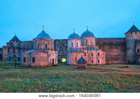 IVANGOROD, RUSSIA - JANUARY 1, 2017: Ancient Church of Saint Nicholas and Church of Dormition of the Mother of God on territory of Ivangorod Fortress that was built in 1492. Now it is a museum.