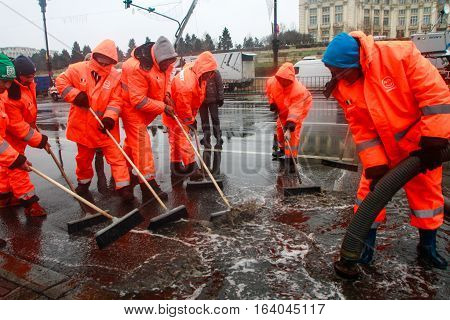 BUCHAREST ROMANIA DECEMBER 1 2014: Public service workers are working on swage after heavy precipitations in Bucharest.