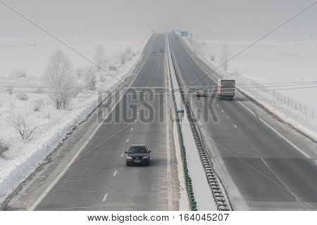 A2 Highway Romania January 23 2016: Cars are passing on the highway A2 the main commercial route which connects Bucharest to the Black Sea's port Constanta.