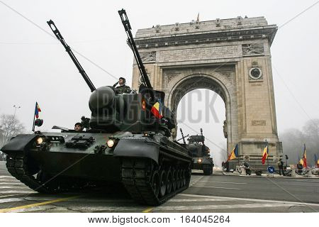 BUCHAREST ROMANIA - DECEMBER 1 2008: Soldiers are marching in heavy machinary during a military parade in Bucharest. More than 3000 soldiers and personnel from security agencies take part in the massive parades on National Day of Romania.
