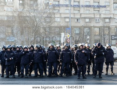 Bucharest Romania January 26 2016: Romanian Gendarmes are participating to a protest in front of the Governmental building in Bucharest.