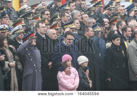 BUCHAREST ROMANIA - DECEMBER 1 2008: Romanian officials are taking part to a military parade. More than 3000 soldiers and personnel from security agencies take part in the massive parades on National Day of Romania.