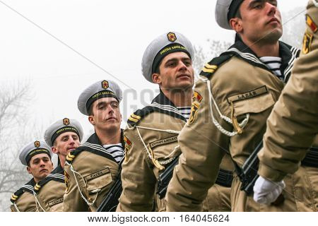 BUCHAREST ROMANIA - DECEMBER 1 2008: Soldiers are marching during a military parade in Bucharest. More than 3000 soldiers and personnel from security agencies take part in the massive parades on National Day of Romania.