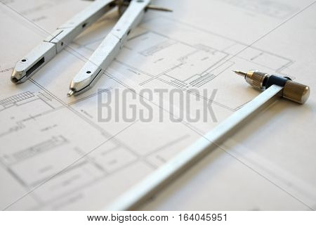 building project and tool professionls on a engeneer table