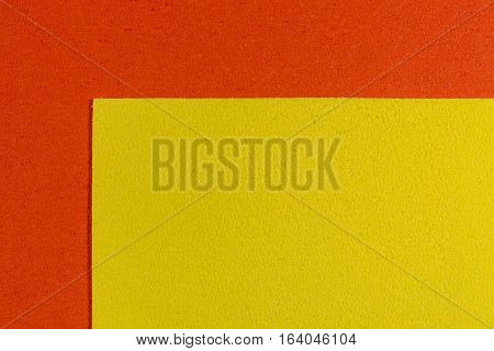 Eva foam ethylene vinyl acetate lemon yellow surface on orange sponge plush background