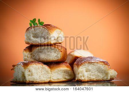 sweet rolls with raisins on the orange table