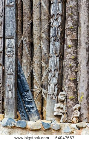 Detail of wood carving of animals on pillars at traditional Fon's palace in Bafut, Cameroon, Africa.
