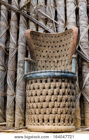 Elaborate African wood carved chair at traditional Fon's palace in Bafut, Cameroon, Africa.