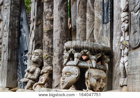 Chair and other African wood carvings at traditional Fon's palace in Bafut, Cameroon, Africa.