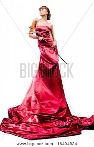 Beautiful girl in a long red dress holds an exotic flower in a hand on a white background