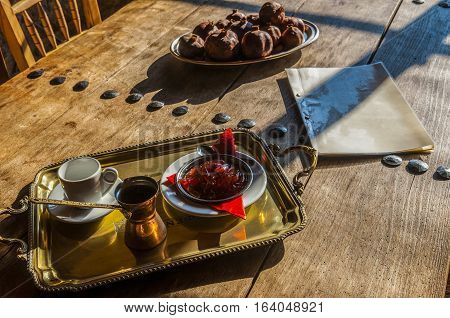 coffee in coffee pot with jam on wooden table