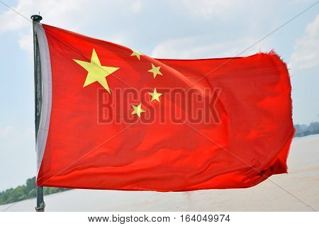 Flag of China on the Yangtze River in Nanjing, Jiangsu Province, China.