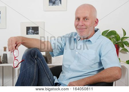 portrait of handsome mature man with a blue shirt