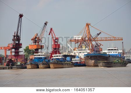 NANJING, CHINA - JUL. 22, 2012: Ships at port of Nanjing by the bank of Yangtze River. Port of Nanjing is the largest inland port of China, Jiangsu Province, China.