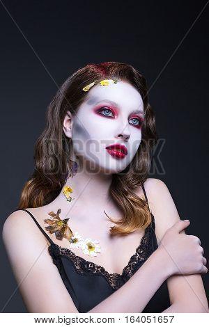 beautiful girl posing in a studio, makeup for Halloween