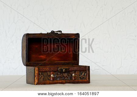 Open old wooden casket on a white background space for text