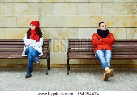 Young couple looking in different directions . Insult each other