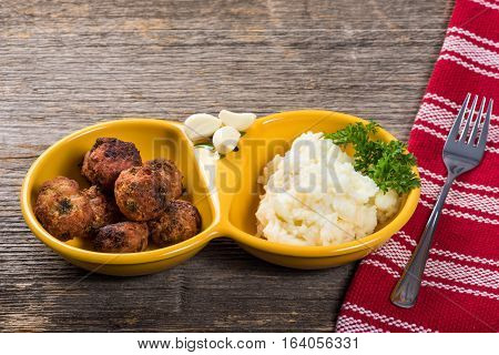 Meat patties with mashed potatoes on the table in natural light