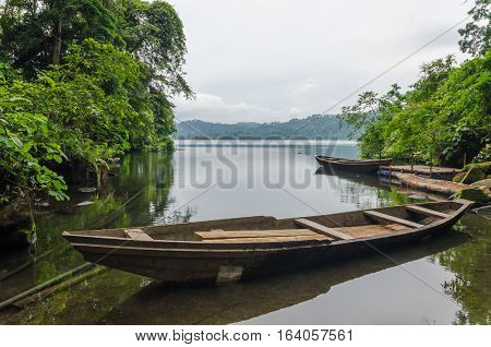 Traditional wooden fisher boat anchored at Barombi Mbo crater lake in Cameroon, Africa.