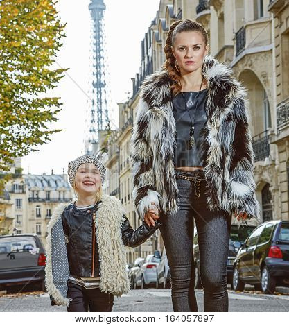 Mother And Daughter Nearby Eiffel Tower In Paris, France Walking