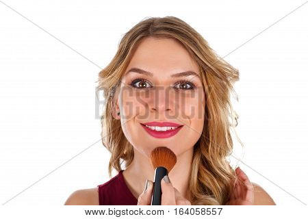 Portrait of a beautiful woman finishing her make-up