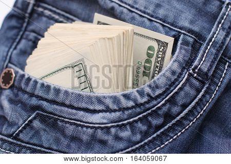 cash in pocket jeans selective focus, business background
