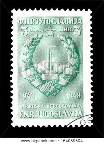 YUGOSLAVIA - CIRCA 1948 : Cancelled postage stamp printed by Yugoslavia, that shows Coat of arms of Bosnia and Herzegovina.
