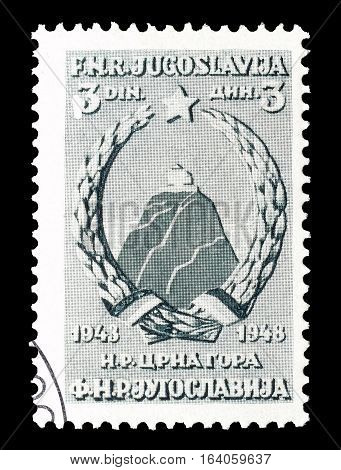 YUGOSLAVIA - CIRCA 1948 : Cancelled postage stamp printed by Yugoslavia, that shows Coat of arms of Montenegro.