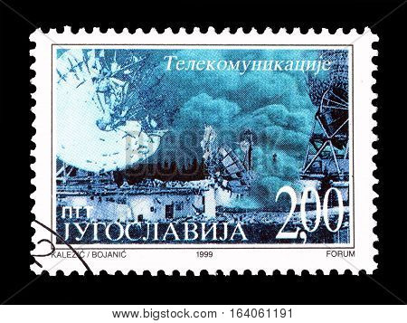 YUGOSLAVIA - CIRCA 1999 : Cancelled postage stamp printed by Yugoslavia, that shows Bombarding of Telecommunications.