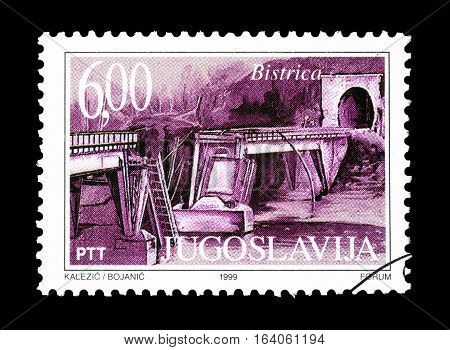 YUGOSLAVIA - CIRCA 1999 : Cancelled postage stamp printed by Yugoslavia, that shows Bombarding of Bistrica bridge.