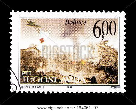 YUGOSLAVIA - CIRCA 1999 : Cancelled postage stamp printed by Yugoslavia, that shows Bombarding of Hospitals.