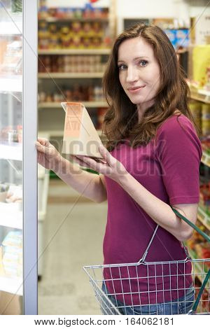 Portrait Of Woman Buying Sandwich From Supermarket
