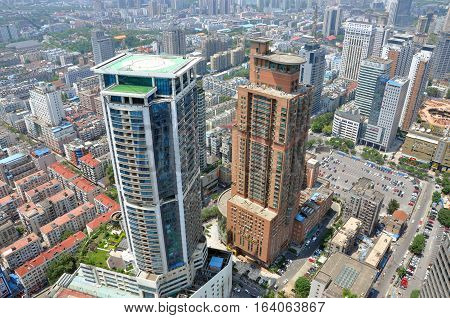 NANJING, CHINA - AUG. 6, 2012: Aerial view of Nanjing City center skyline (West) with TianAn International Building on the left and Jianhua Building on the right, Nanjing, Jiangsu Province, China.