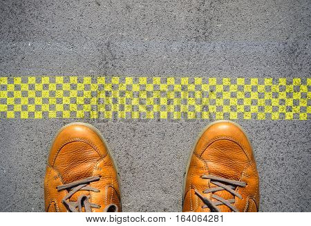 Start a new career concept with man feet at start line